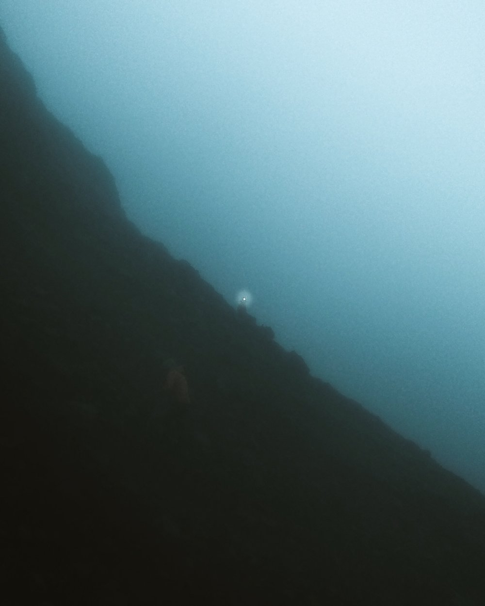 In the dark of dusk, we found fog laden mountains that rendered the grown wet beneath us. The rock slipped constantly and once we got to a point no longer surpassable we simply laid down our efforts.