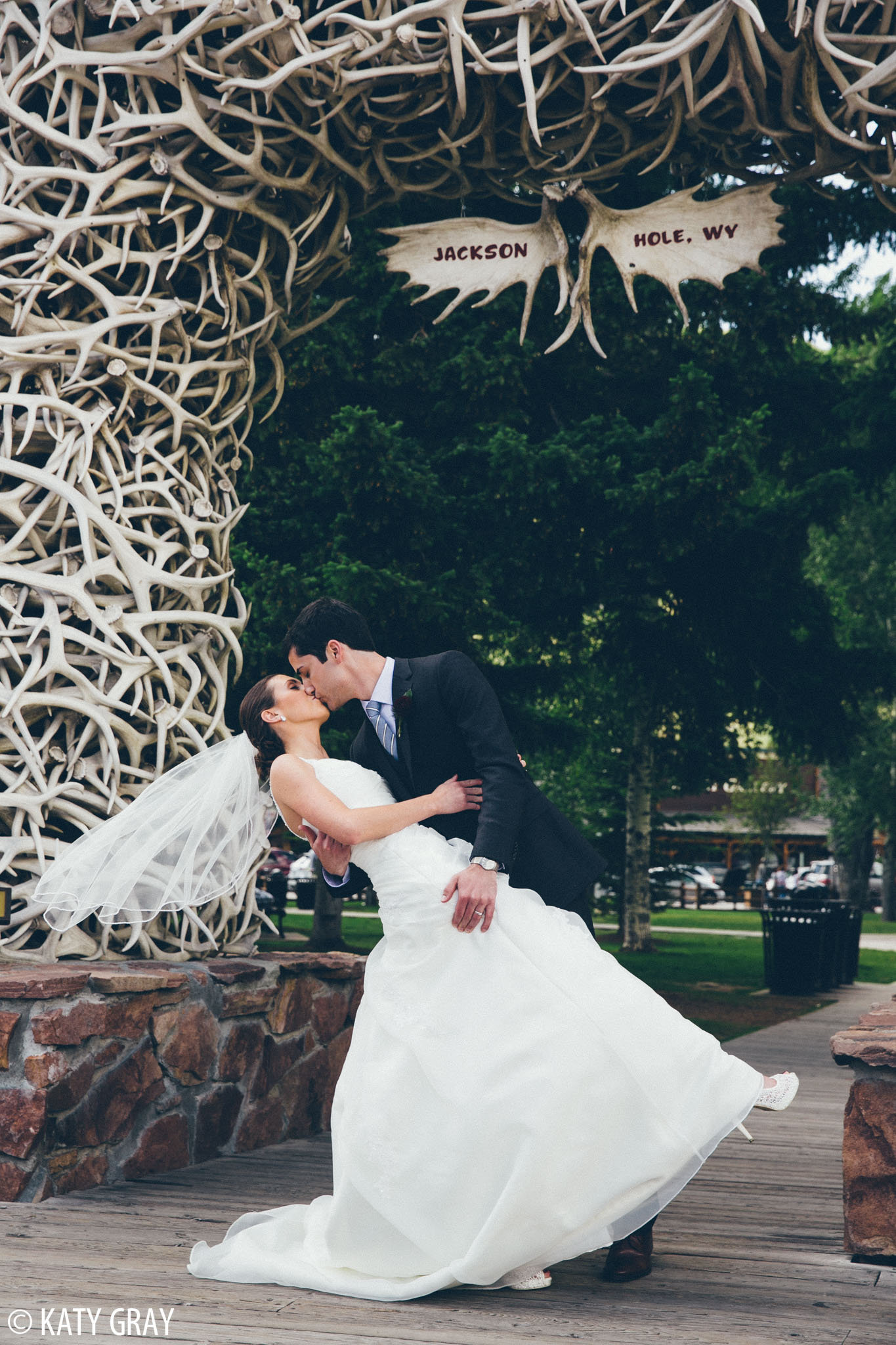 Jackson Hole wedding photos under antler arch