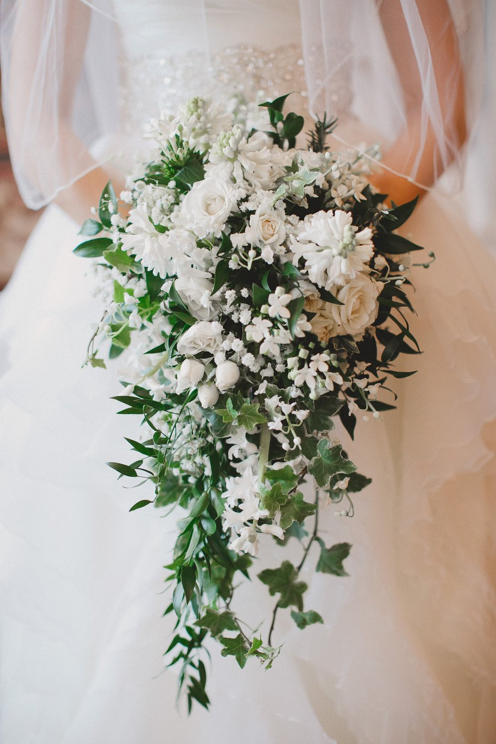 White Cascading Bouquet by Fache Floral Design