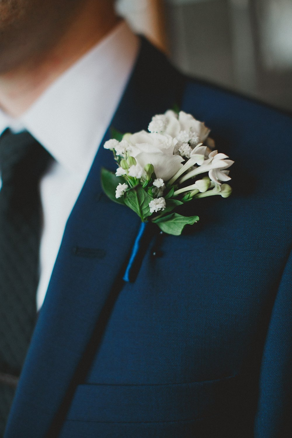 White Groom Boutonniere by Fache Floral Design Winnipeg