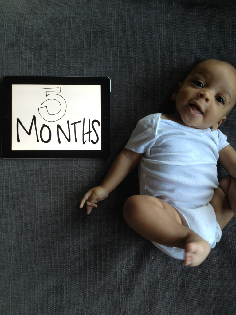 5 whole months!  really?!    our sweet little angel boy turned 5 months yesterday and i am at a loss for words.  how does time fly so fast with a little one?  all of those cliches that you've heard all of your life?  you know, the 'they grow up so fast,' the 'time flies when you have a kid', those, yeah, it's true.  probable cause for the cliche.    one day, they they have no idea they have feet and the next day, they're in happy baby pose all day long.    i've learned so much in the last 5 months about everything that i can't imagine how i'm going to retain the things i'll learn for the rest of my life.    luckily, i have the sweetest, lovingest, coolest 5-month-old around.  yep, you see it.