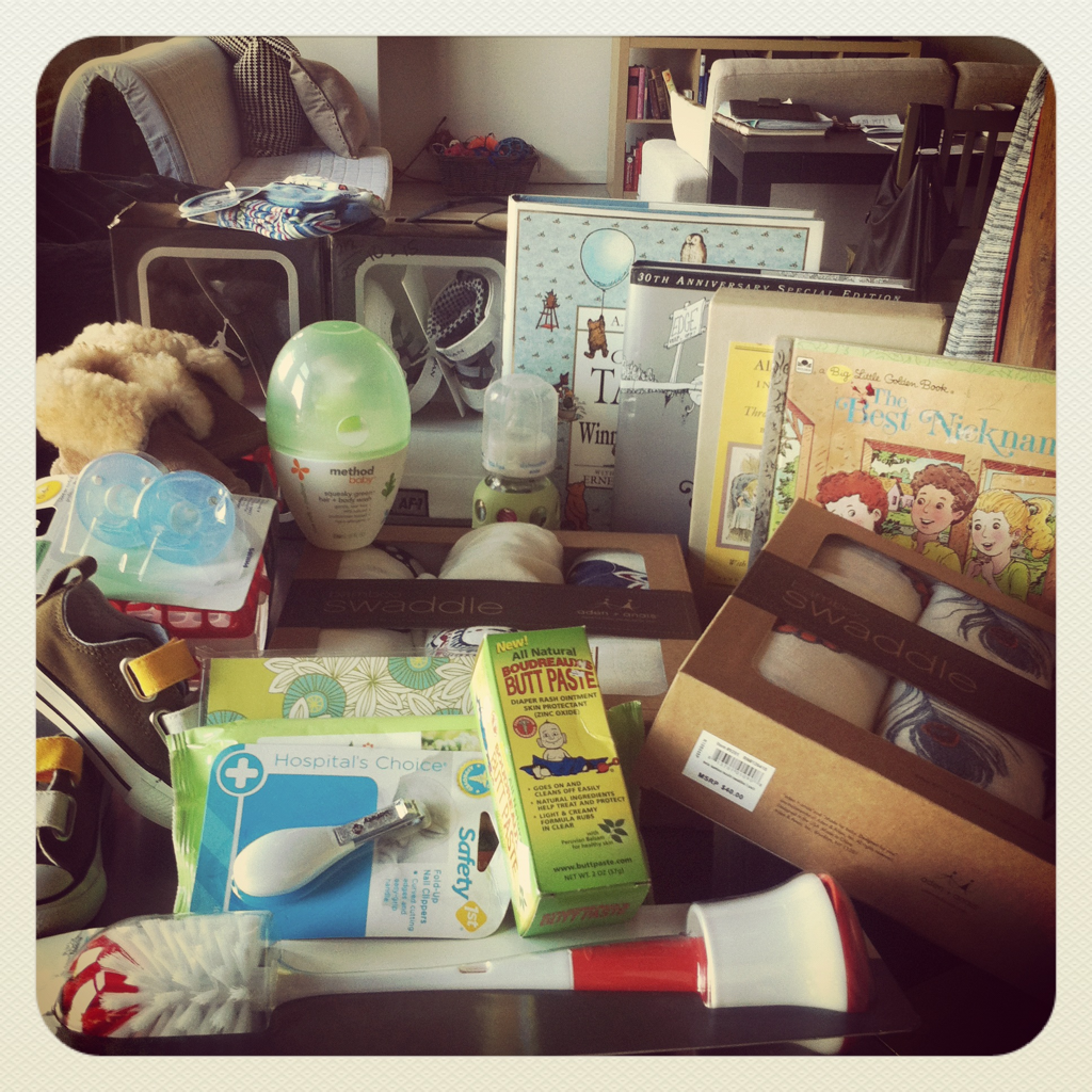 check out all of the bean's goodies!  if you look closely, you can see which shoes he'll be wearing with his daddy and which ones he'll wear with me.    the bigger purchases are the ones that scare me (the stokke stroller i can't stop thinking about, the classic and modern oeuf sparrow crib and changing tray…) and i'm still on the hunt for the perfect mid-century modern credenza/dresser for his changing table!