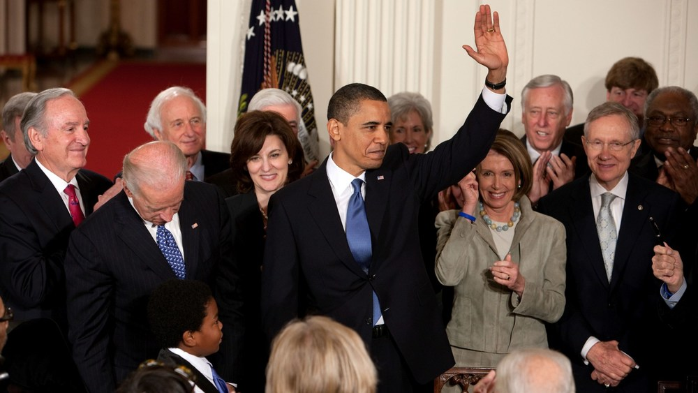 President Obama, after signing the Affordable Care Act into law. Photo Credit: White House.