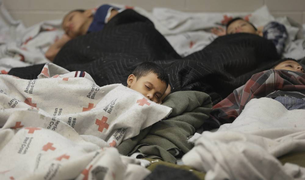 Migrant children sleep at a processing center. Credit: Eric Gay/The Associated Press/Dallas News.