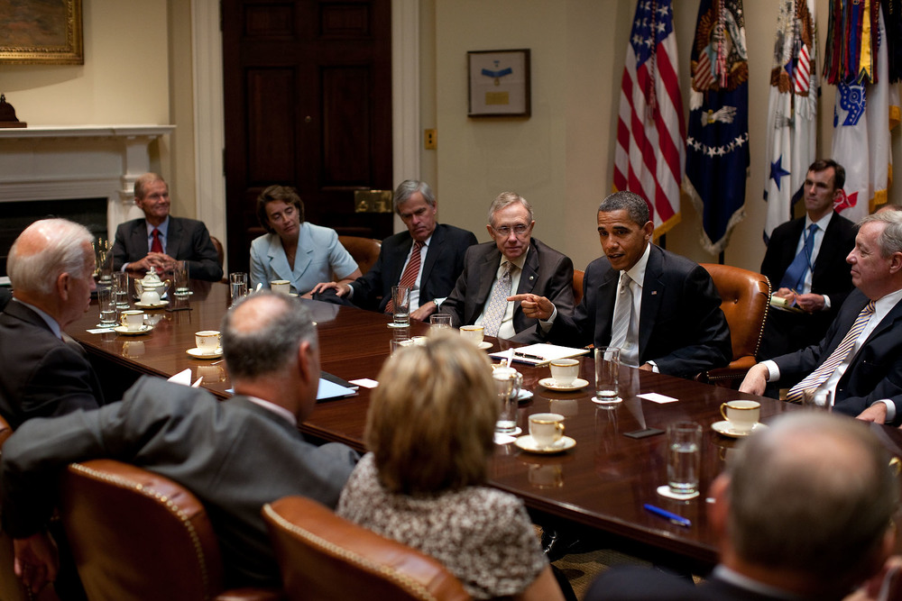 President Obama and key policymakers huddle before the final votes on Dodd Frank.