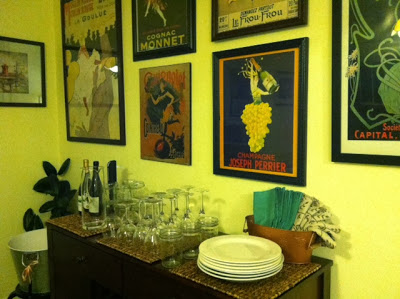 Sideboard with plates, glasses, napkins, flatware, and beverages