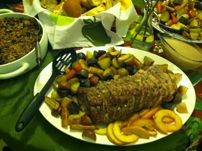 Roasted root vegetables, pork loin, and apples