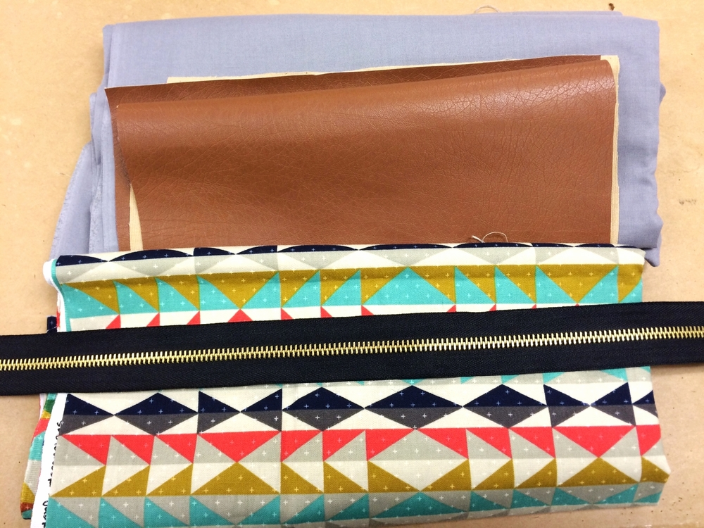 I got my lining and patterned fabrics at Pacific Fabrics and the leather and zipper at Joann's