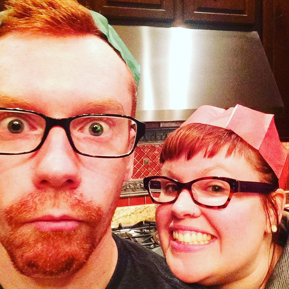 My brother and I celebrating in our charming paper hats