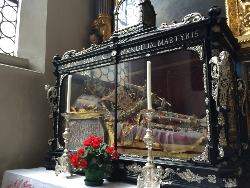 Sainte Munditia's bejeweled remains at St Peter's Cathedral. She is the patron saint of single women (so badass!).