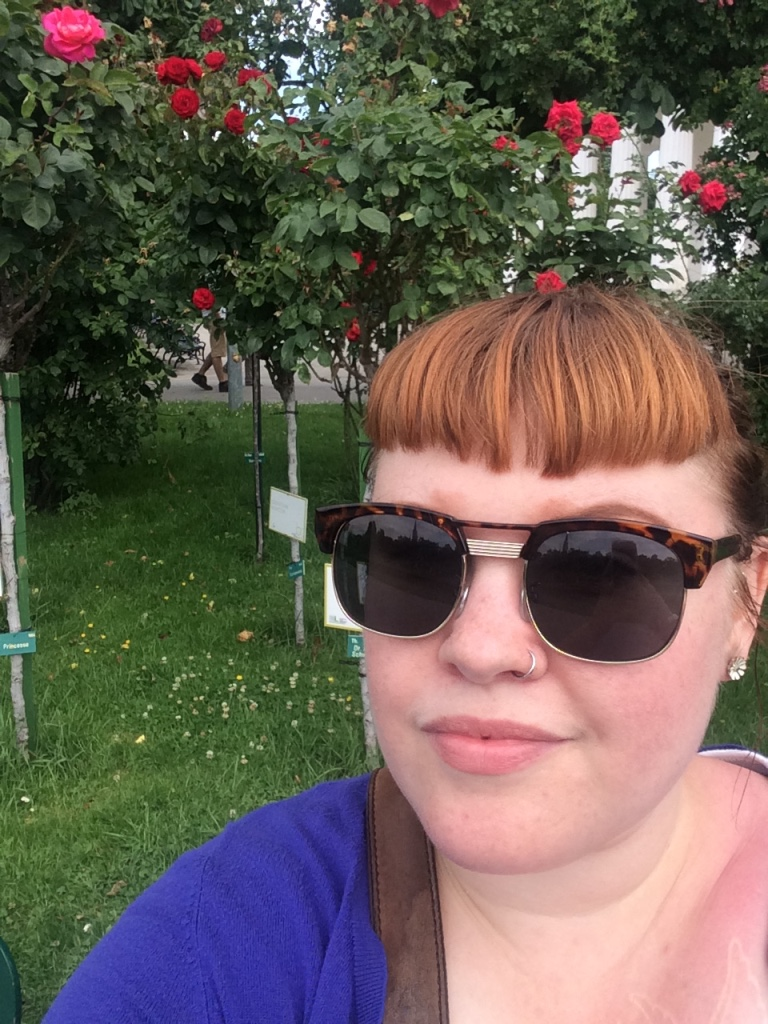 I took a self-guided walking tour that led me to the Volksgarten's rose garden. Also note the giant sunburn :-(