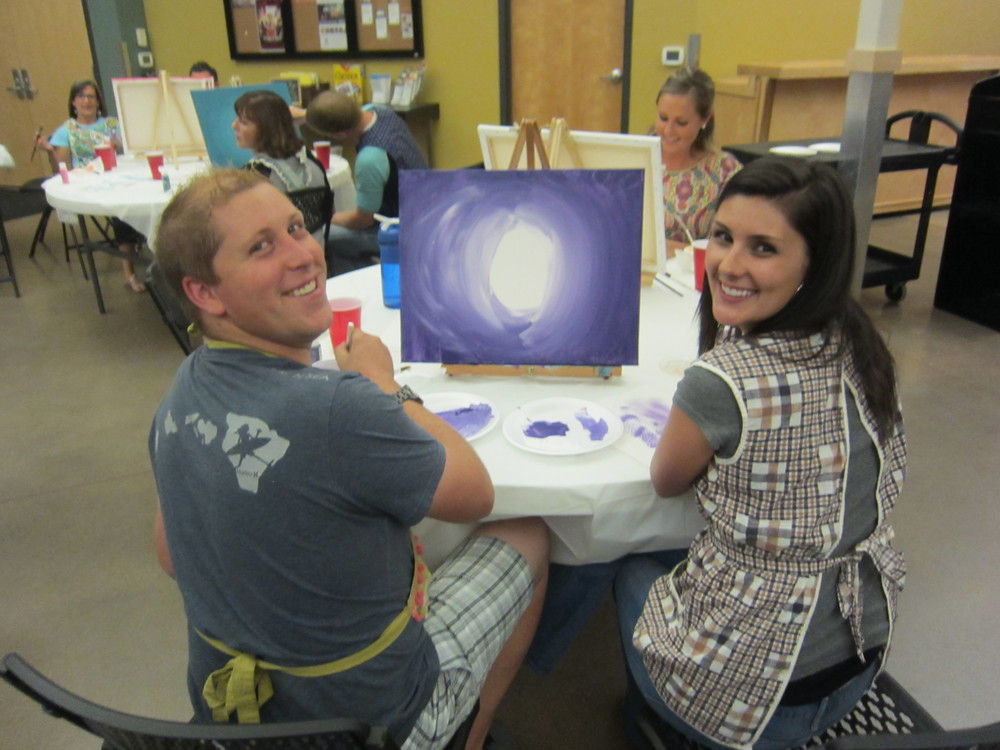 Chris and Liz and their purple creation