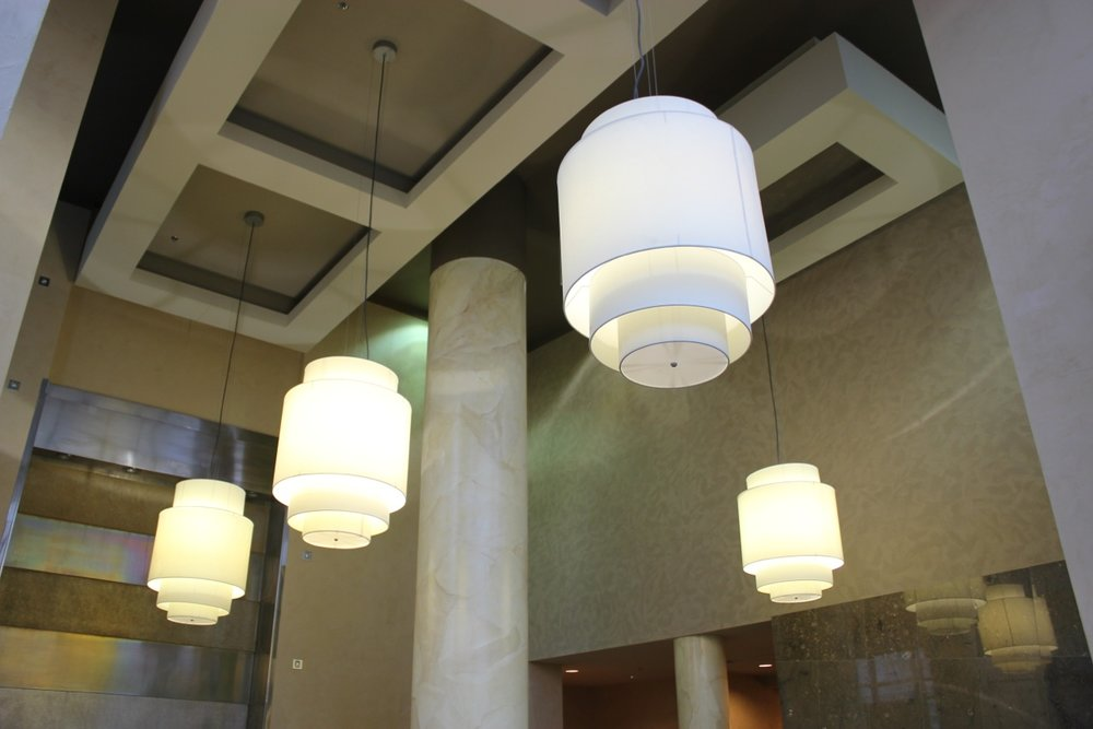 Condos - From polished venetian plaster halls to giant marbleized pillars. Give your condo the grand entrance it deserves.