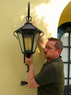 This 'Auberge' fixture by Hans Duus Blacksmith hides a GU 24 CFL inside a resin candle www.hansduusblacksmith.com