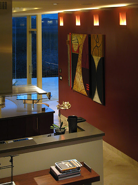 This kitchen uses a series of in-wall indirect light fixtures, made by Belfer Lighting, to help create fill light for the space. These fixtures are available in a halogen or a dimmable fluorescent version. Interior Design- Marian Wheeler     Lighting Design- Randall Whitehead     Photography- Dennis Anderson
