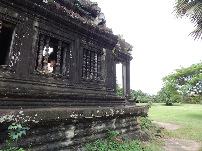 Angkor Wat has been an active place of worship since the original planning/construction in the 12th century. This little girl is the latest in a long line of generations to live in and around the temple complex.