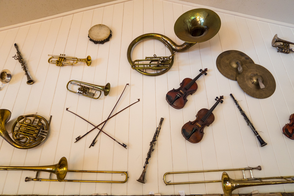Zack Smith Photography North Carolina Brevard School of Music Center instruments Trumpet Violins Trombones clarinet music wall