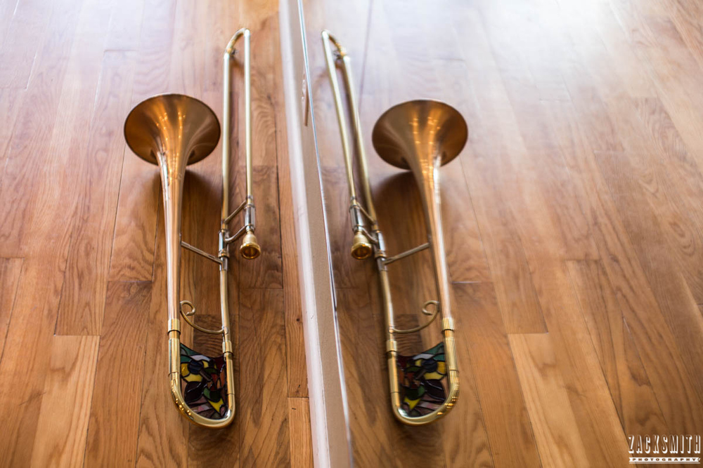 St Charles Vision portrait photo shoot with Zack Smith Photography New Orleans trombone reflection mirror wood floor instrument