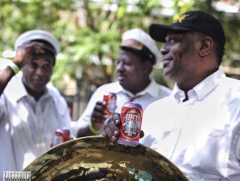 The Tornado Brass Band cool off with a few cold Abita Jockamo IPA's before their set