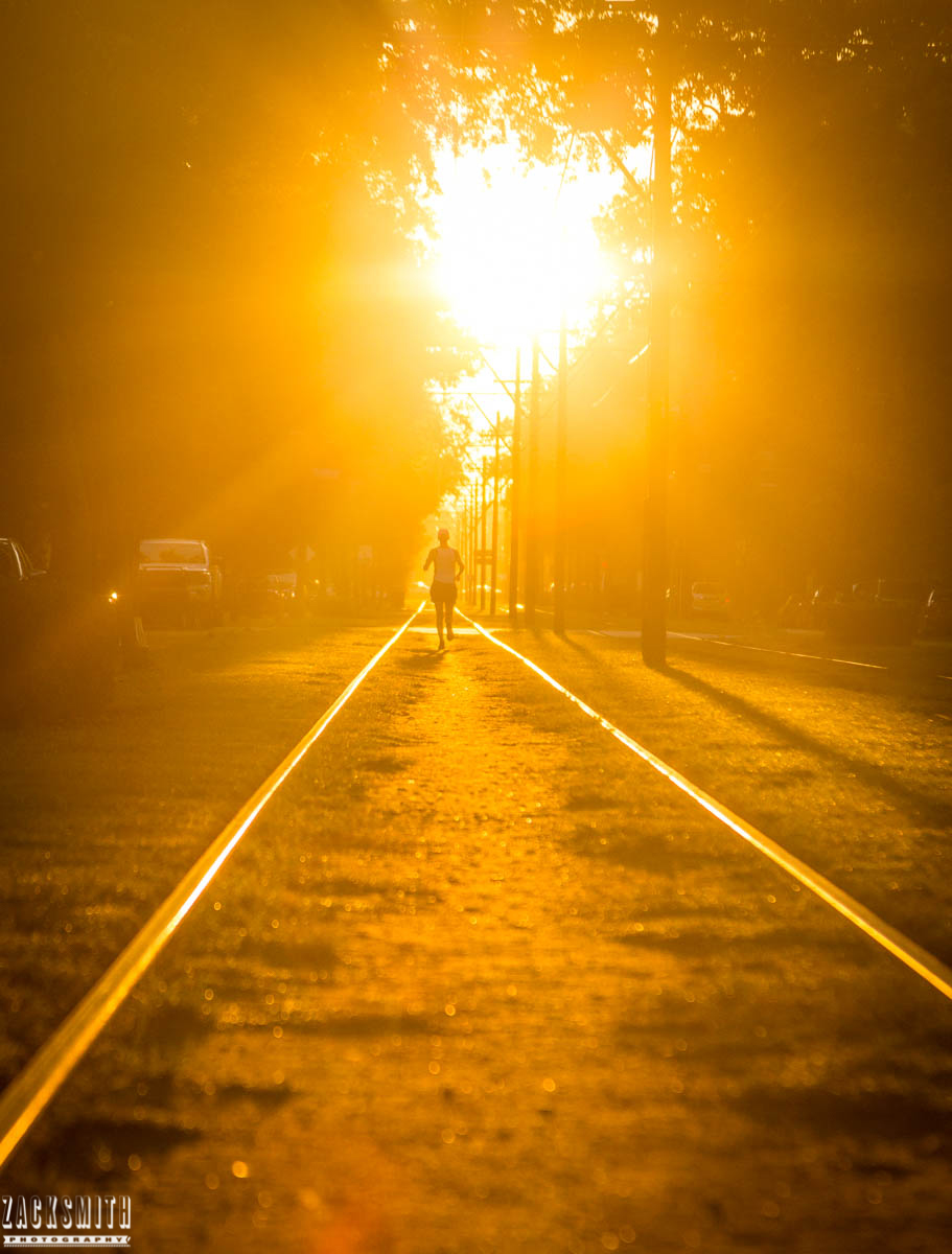 jogger-sunrise-streetcar-tracks-st-charles-avenue-zack-smith-photography-new-orleans-photographer