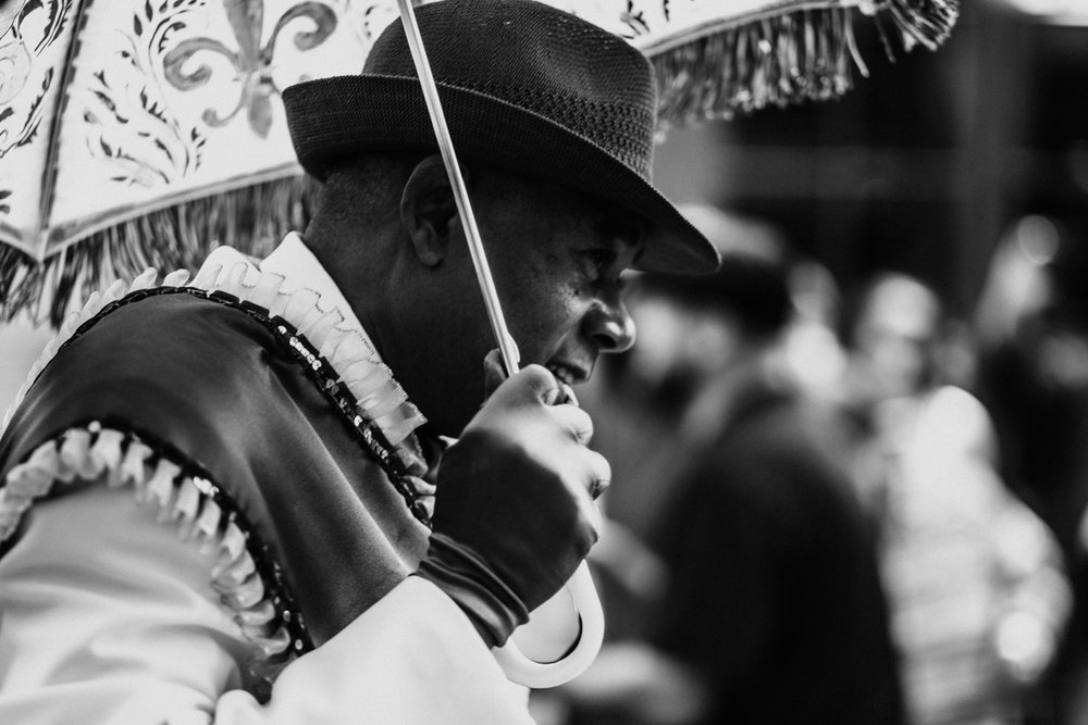 Grand Marshall of the Mahogany Brass Band, Percy Ellis, leads the band through the French Quarter