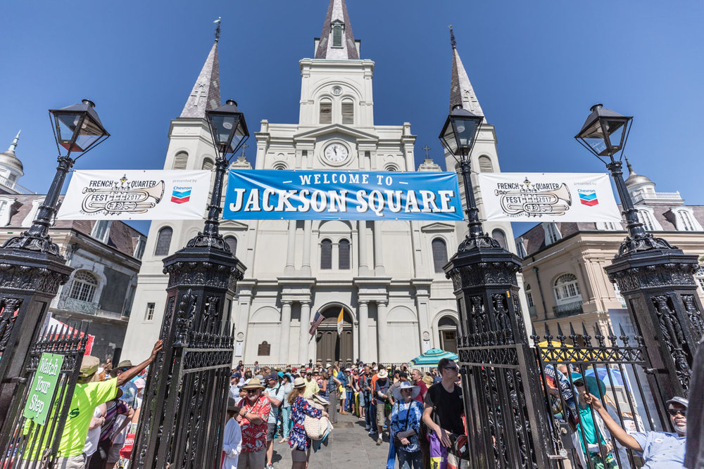Crowds await the chimes of St. Louis Cathedral to ring them in Saturday's fest.