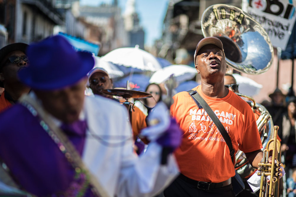 Trumpeter Brice Miller leads the Mahogany Brass Band through the French Quarter to open French Quarter Fest.