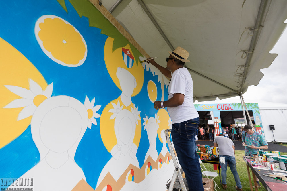 Muralist Roberto Guerra Hechaverria continues his mural at Jazz Fest 2017.