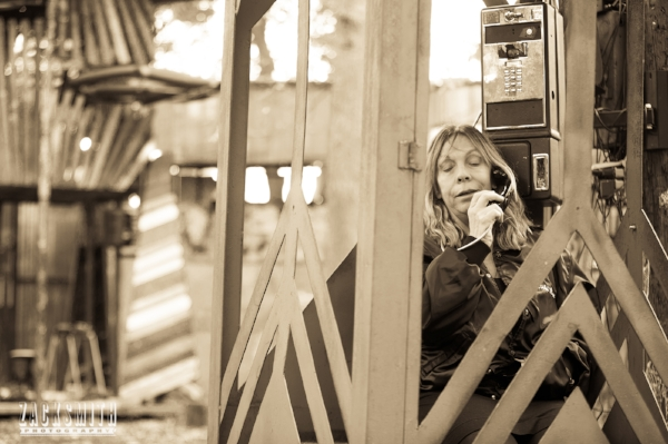 Rickie Lee Jones uses the pay phone on site to sing through it's dual spinning speakers...
