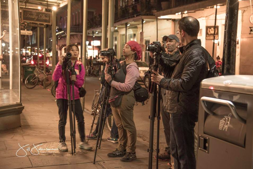 Zack and photographers photographing the night moves of the City of New Orleans! ©Jill Johnson