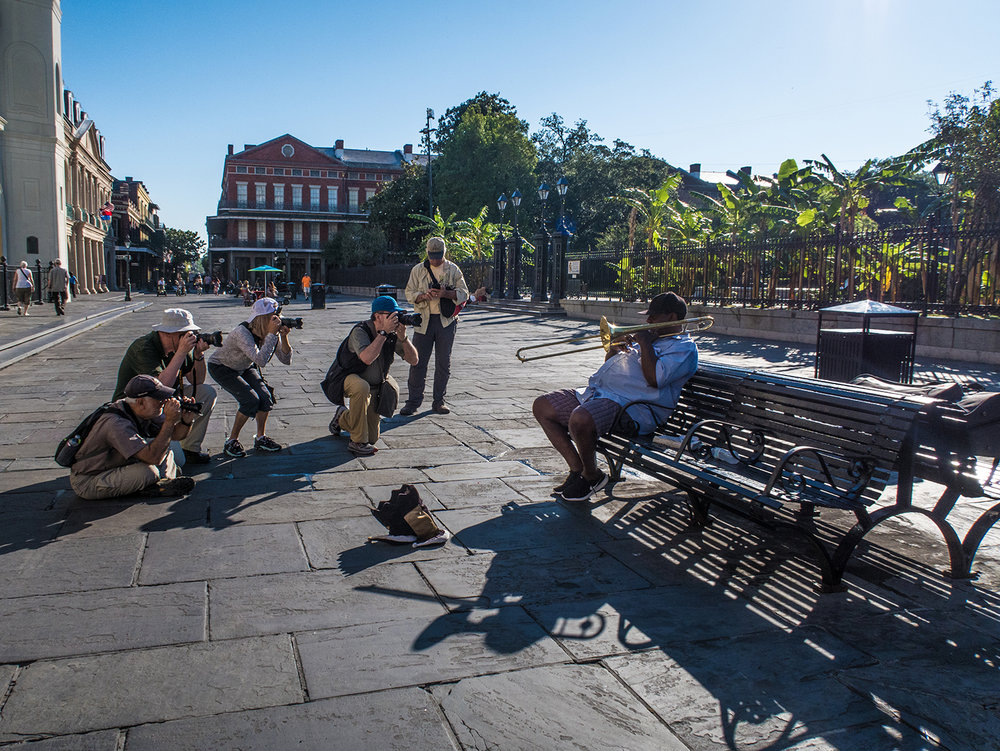Workshop participants photograph trombone player Robert Smith, a mainstay of Jackson Square in the French Quarter. Photo by Zack Smith Photography.