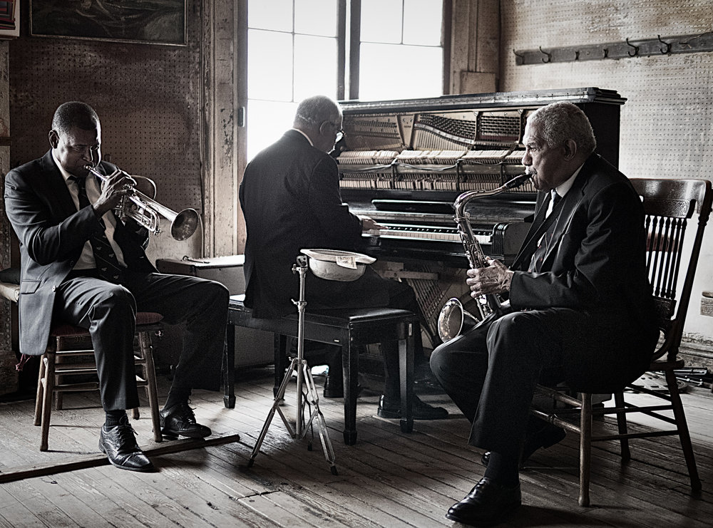 Photograph of Preservation Hall musicians, Will Smith, Rickie Monie, and Daniel Farrow by workshop participant Bruce Janklow, 2017.