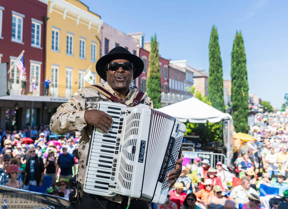 Nathan Williams and the Zydeco Cha Cha's perform on the opening day of FQF2018. ©ZSP