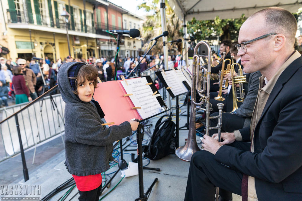 A young fan holds sheet music for Charlie Halloran that was blowing in the wind. ©Zack Smith Photography