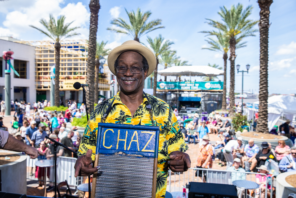 Washboard Chaz and The Tin Men setup to play at the GE Capital Stage on Day One. ©Zack Smith Photography