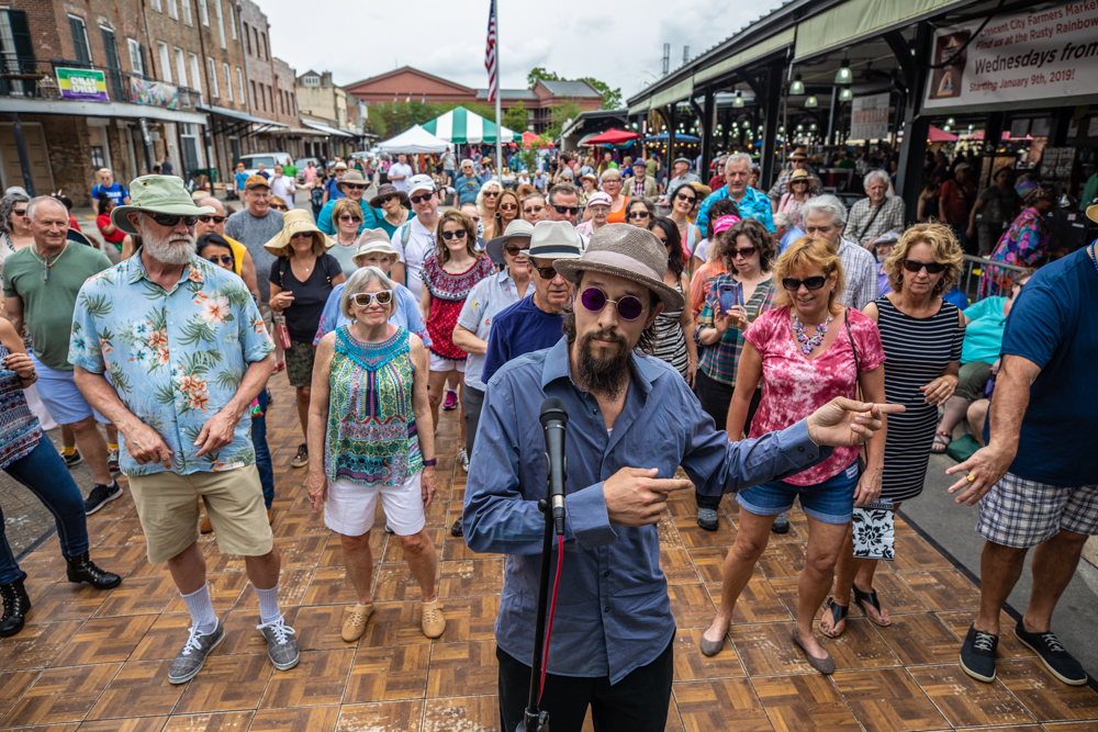 Chance Bushman of the NOLA Jitterbugs gives his daily swing dance lessons as he does so effortlessly! ©Zack Smith Photography