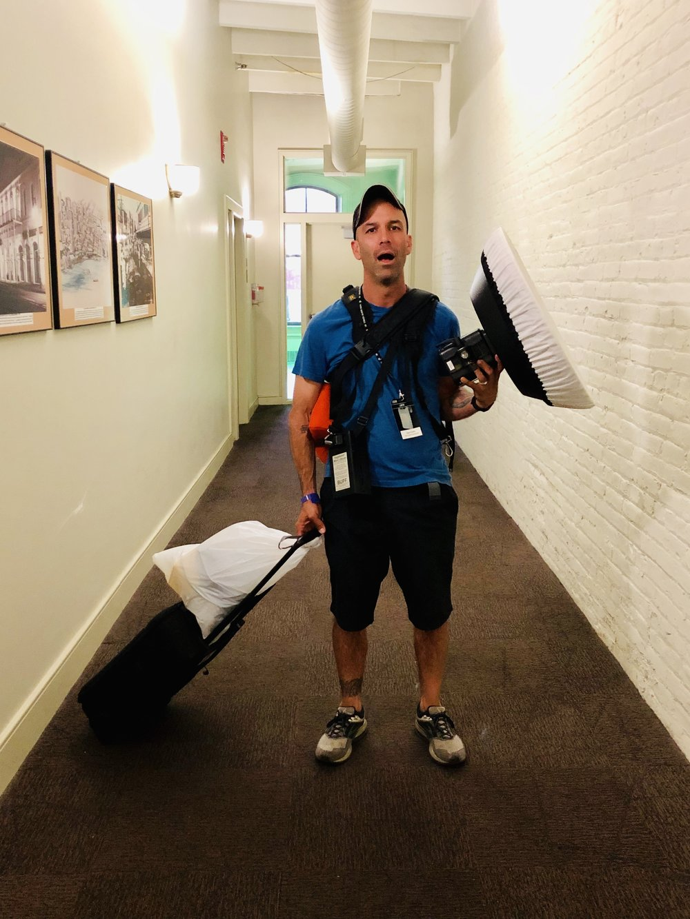 Tired photographer post-fest with gear. Photo by Matt Owens.