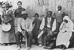 "Underground Railroad leader Harriet Tubman (left) with some of her charges. She allowed no dropping out or turning back and drew a pistol on one discouraged fugitive, saying, "" Move or die."" Source: Bettmann Archives Inc."