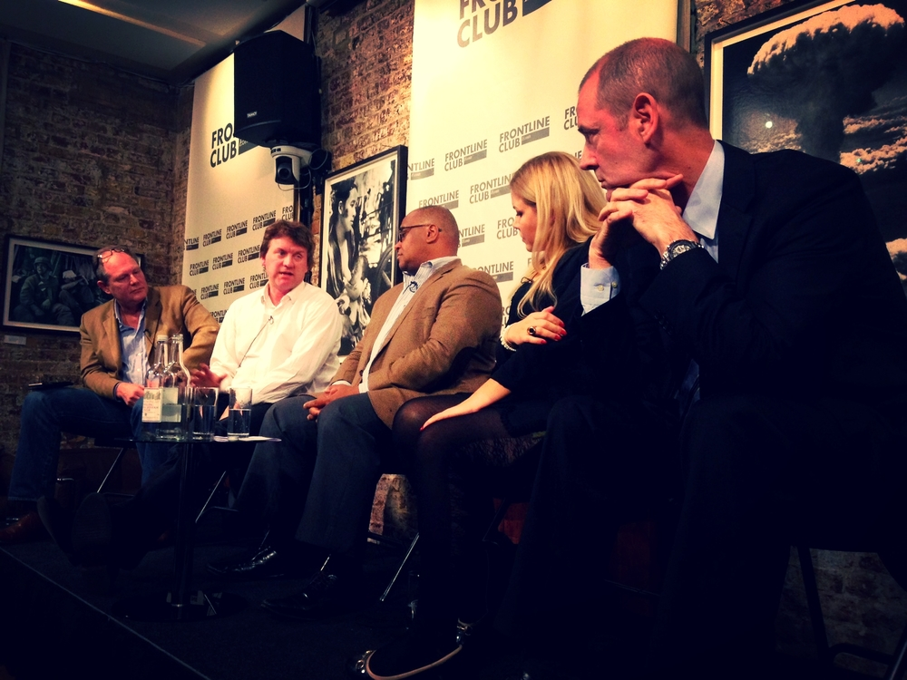 Frontline Club founder Vaughan Smith chats with Ben De Pear of Channel, 4, Marcus Mabry of The New York Times, freelancer Emma Beals, and AFP's David Williams.
