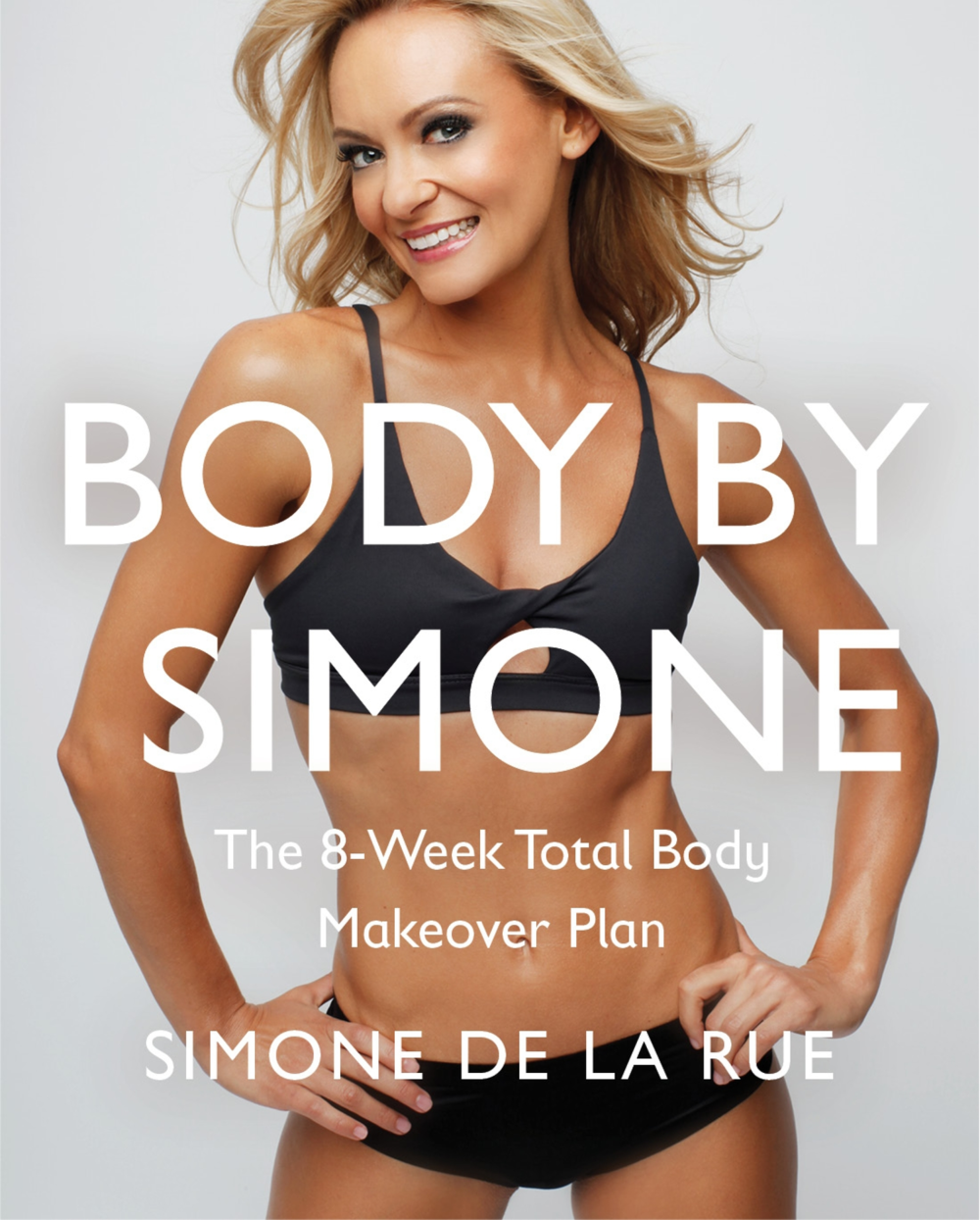 Simone on the cover of her fitness book, available here.