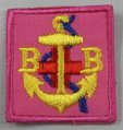 An example of the pink badge