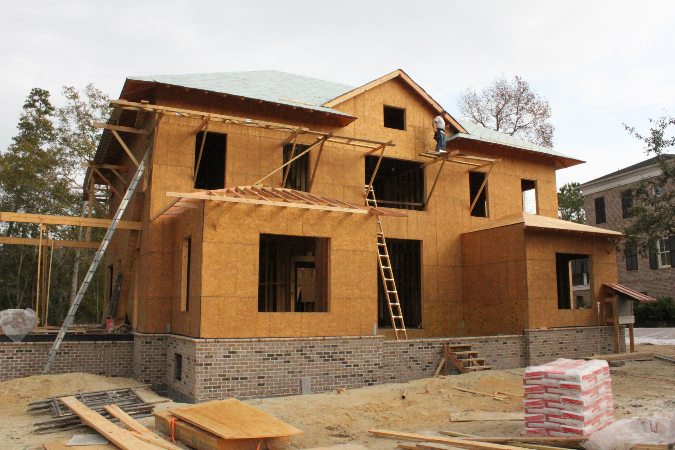 Front elevation developing with the addition of the deep rafter-supported overhangs