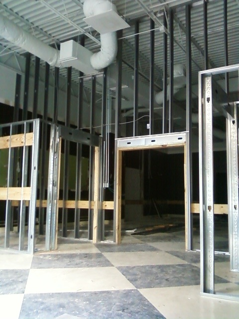 The reception space in the front will include retail and dressing room components.
