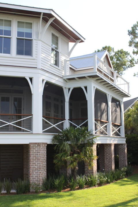 The porches were rebuilt and enlarged, allowing an outdoor dining room at the main level and expanded master deck, above.