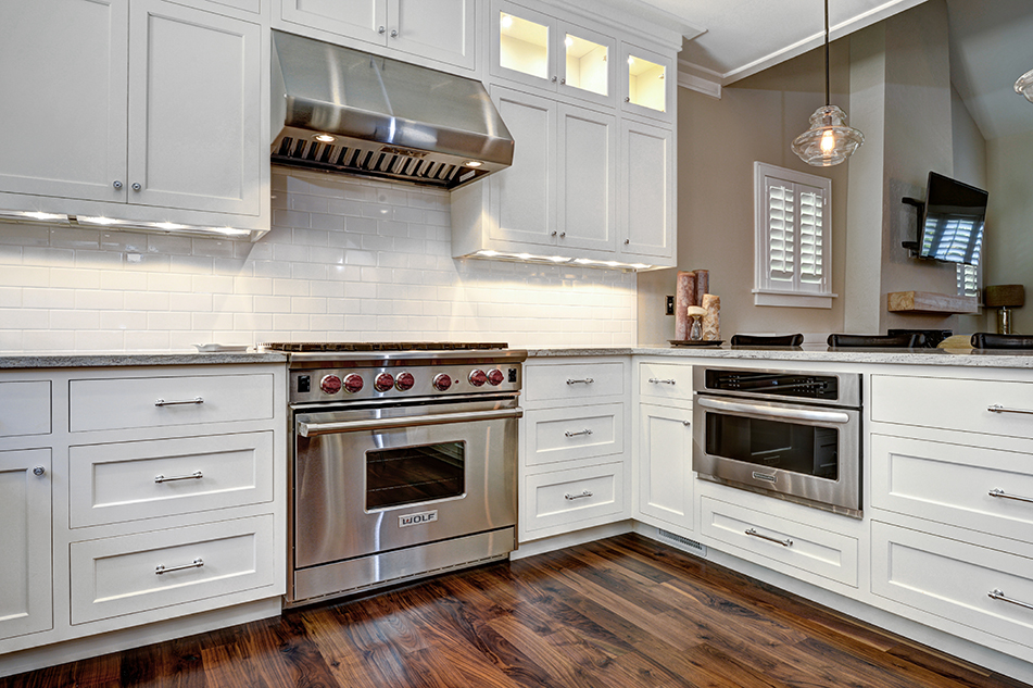 """36"""" Wolf range and Sharp microwave drawer provide the cooking capacity for the kitchen. Photo: Wm. Quarles"""