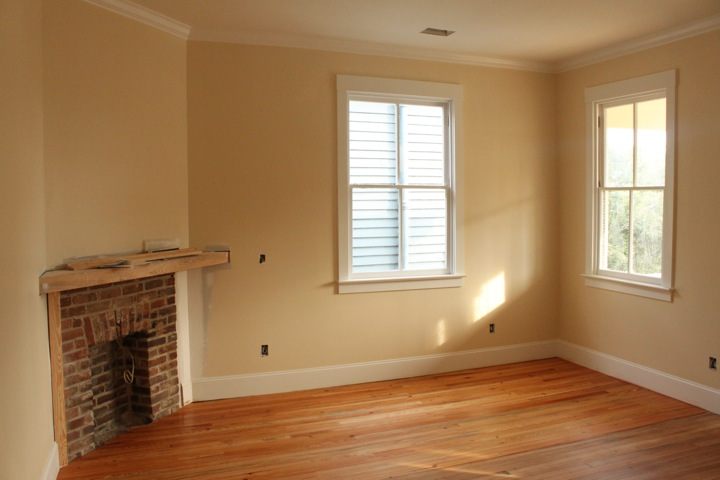Larger of two front bedrooms, after