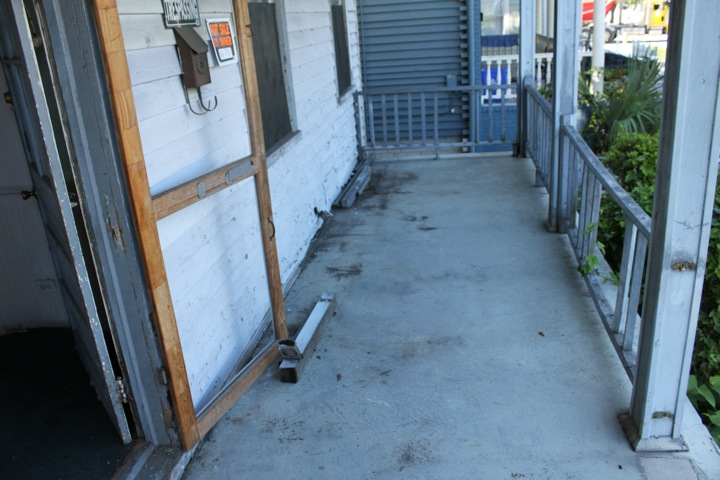Existing front porch, with concrete slab that sloped slightly toward the house.