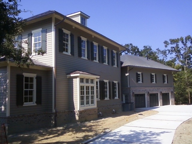 Side of residence with carriage house behind