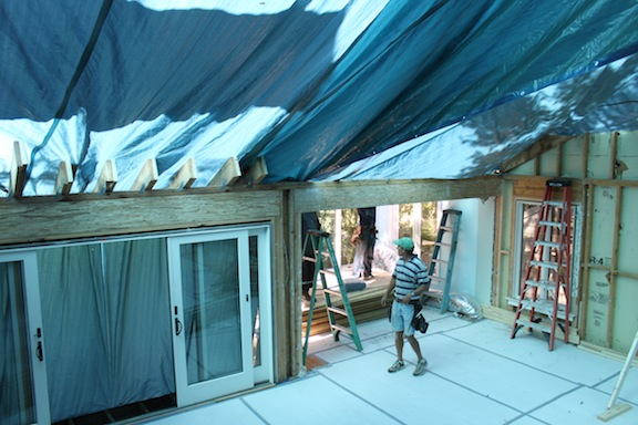 Living spaces covered with tarp after majority of roof demotion has been completed.