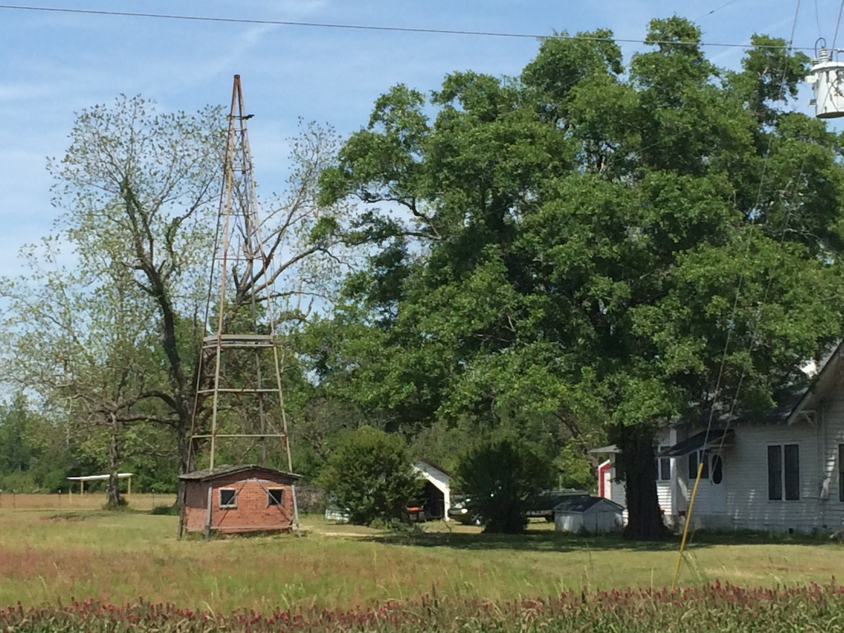 This radio tower and integrated brick shed seen yesterday near Turbeville made me wonder which came first.